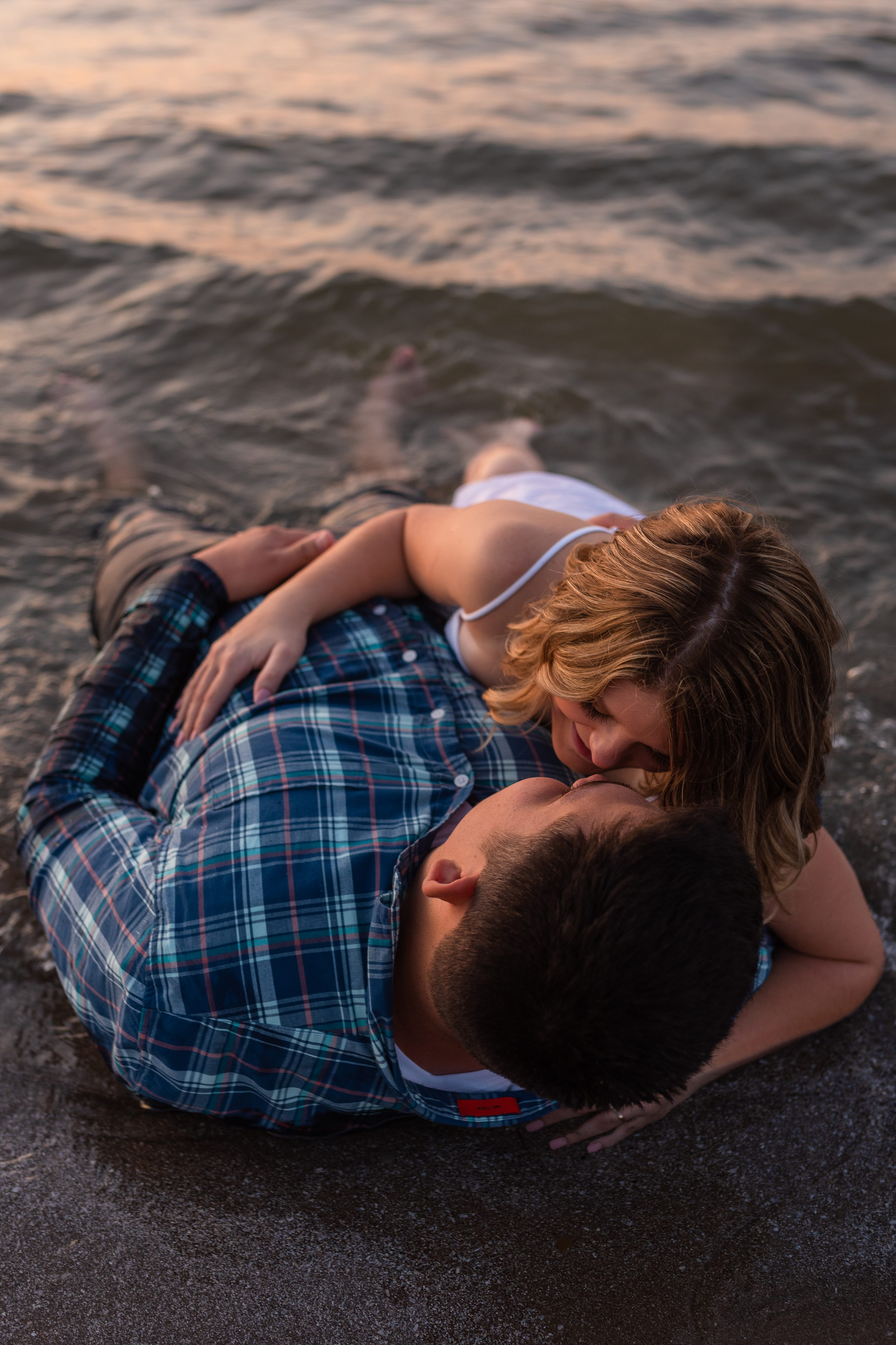 Cleveland Photographer, Downtown Cleveland, Engagement Photographer, Engagement Session, Hannah + Tyler, Hannh and Tyler, Lake Erie, Lake Erie Engagement Session, Lake Erie photos, Ohio Photographer, Wedding Photographer, cleveland engagement photographer, couple in lake, couple in water, couples session, couples session in water, ohio engagement photographer, photos in water, sunset photos