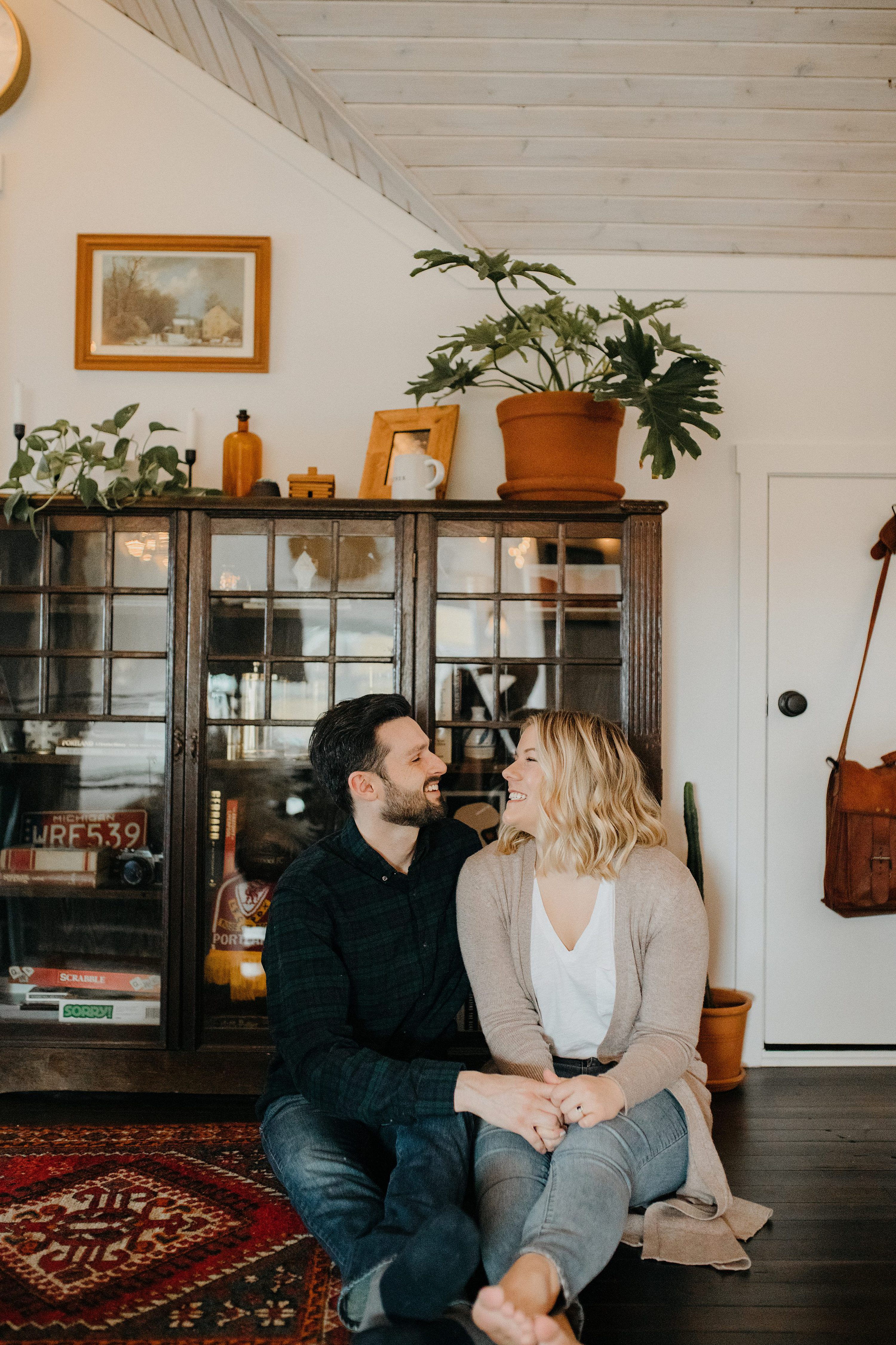 cute couples photos,in home engagement session,candid engagement session,winter engagement session,living room engagement session,engagement photos with dog,couples photos with dog