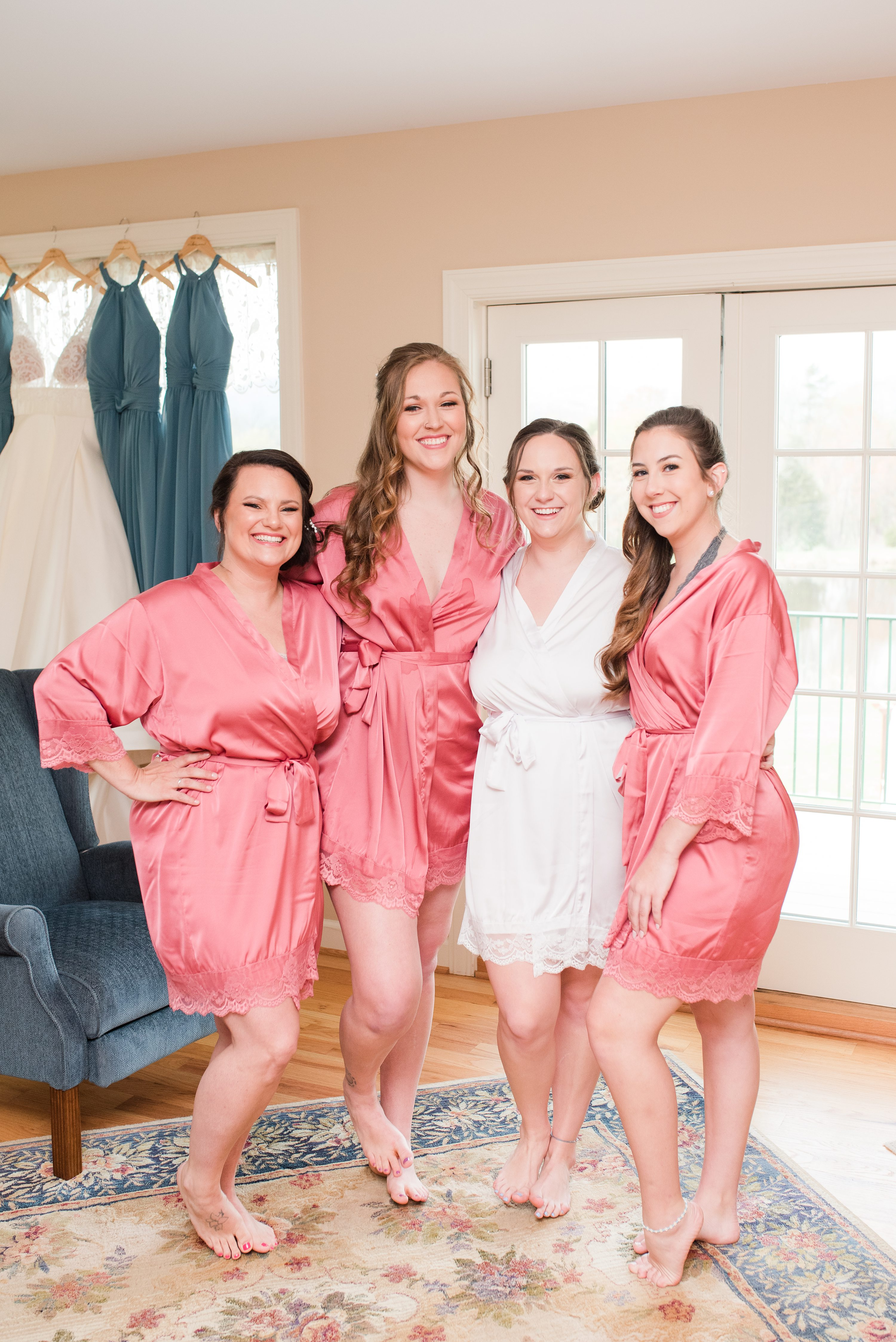 Southern Wedding,bride and bridesmaids,wedding robes,bridesmaids,bridesmaids in robes,bride,bridal party on bed,Charlottesville Wedding Photographer