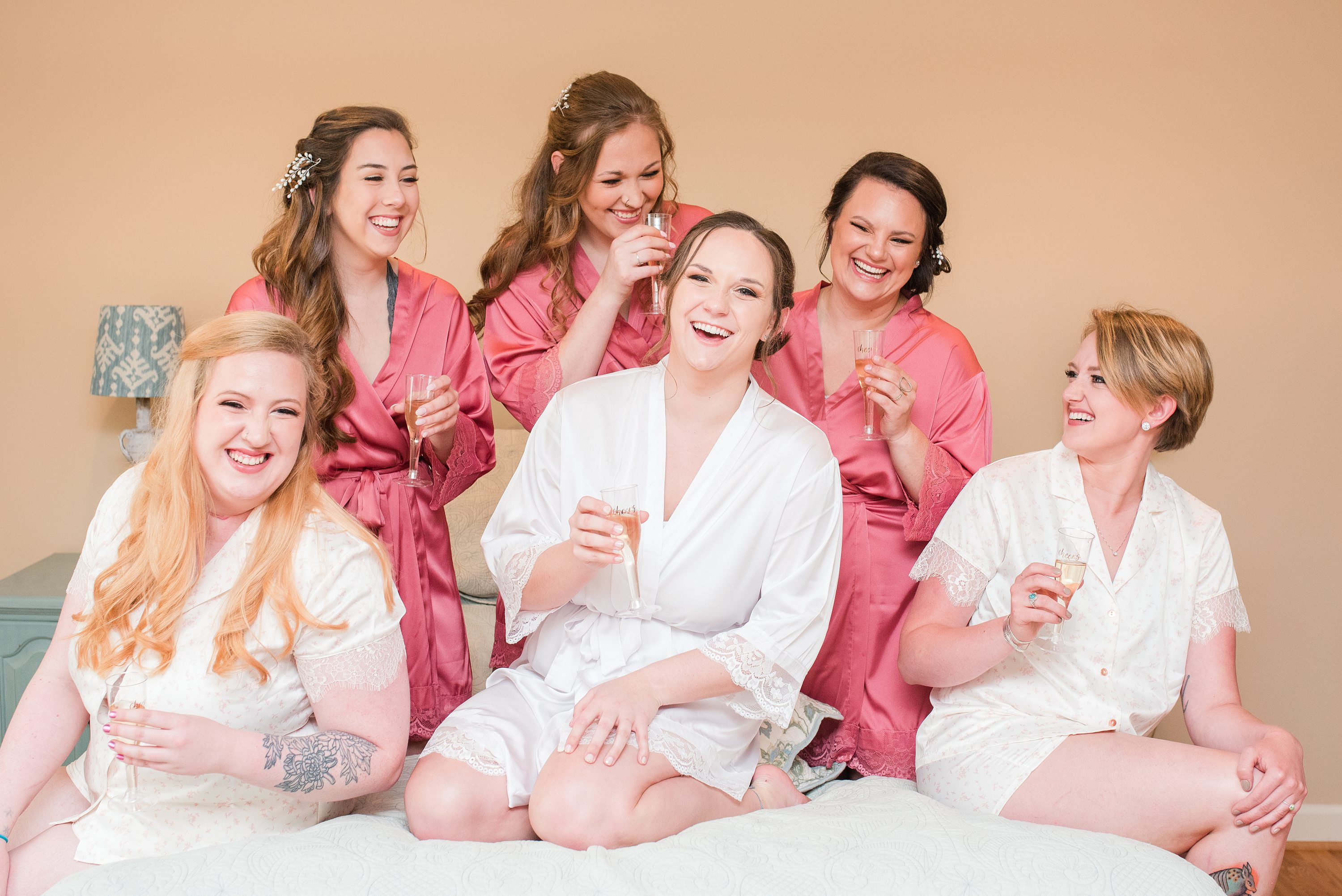 Barn Wedding,Blue Ridge,bride and bridesmaids,wedding robes,bridesmaids,bridesmaids in robes,bridal party on bed,champagne