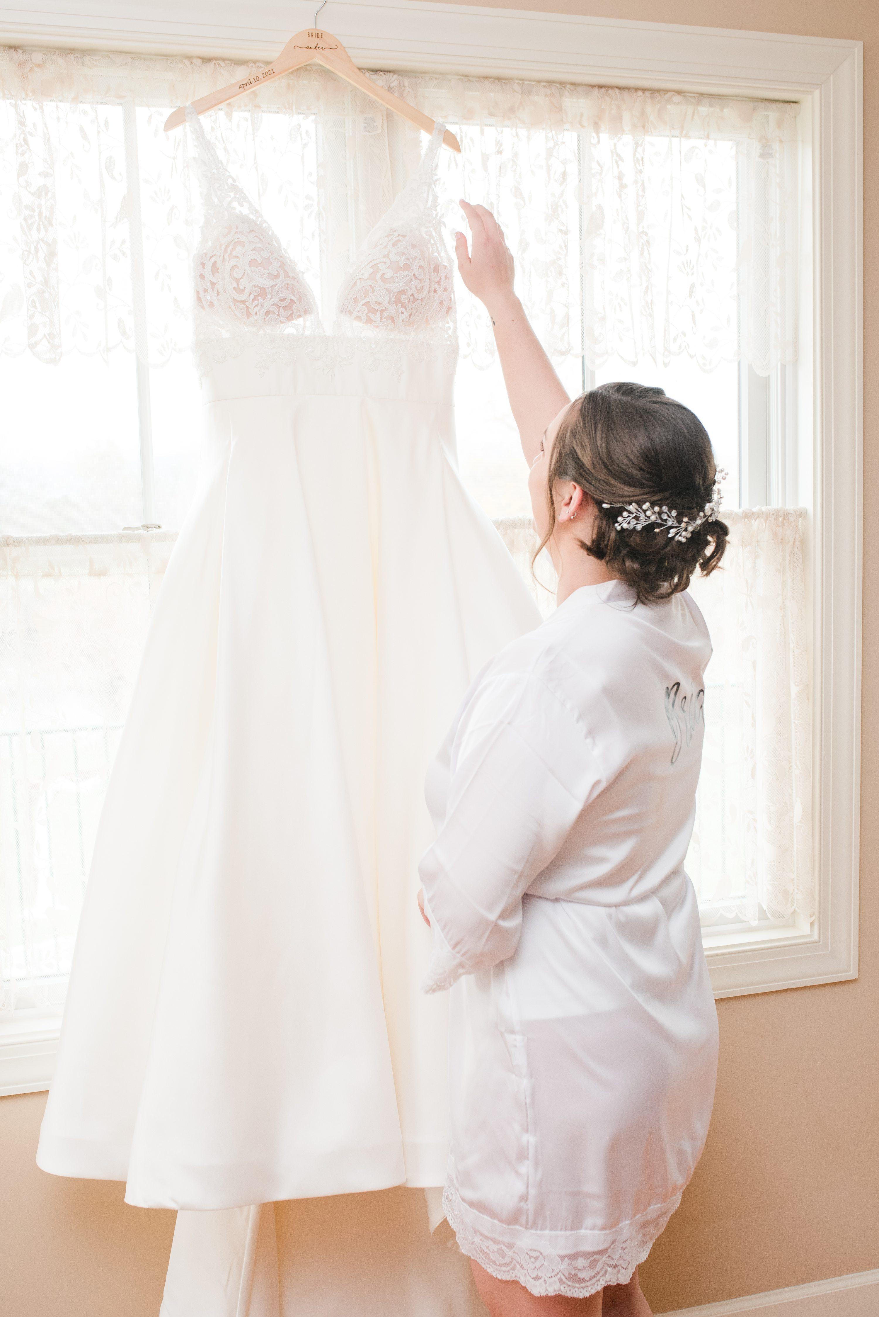 Barn Wedding,Spring Wedding,bride putting on dress,Wedding Dress