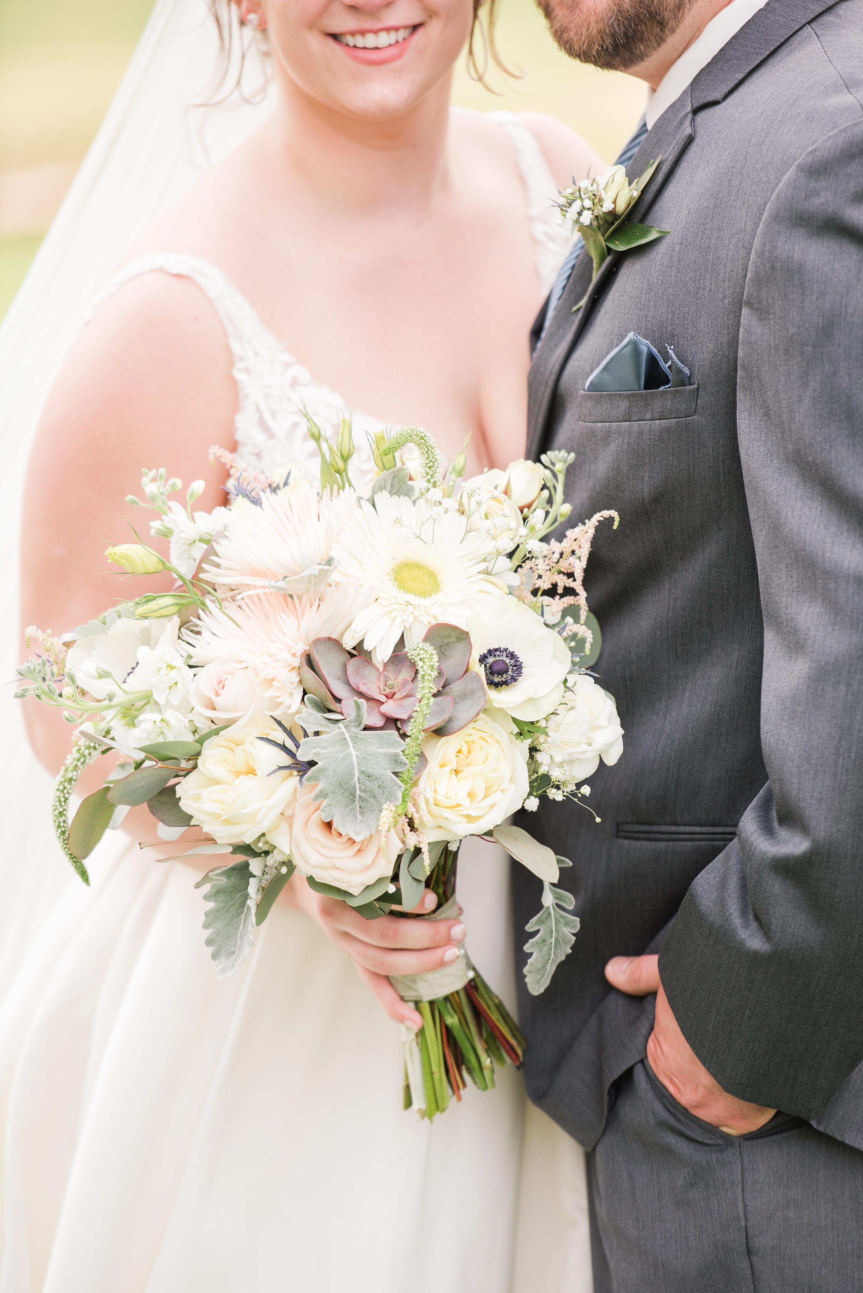 Bright,bride and groom,mountain wedding,edgewood barn,bouquet