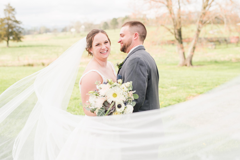 Edgewood,Spring,bride and groom,mountain wedding,veil shot