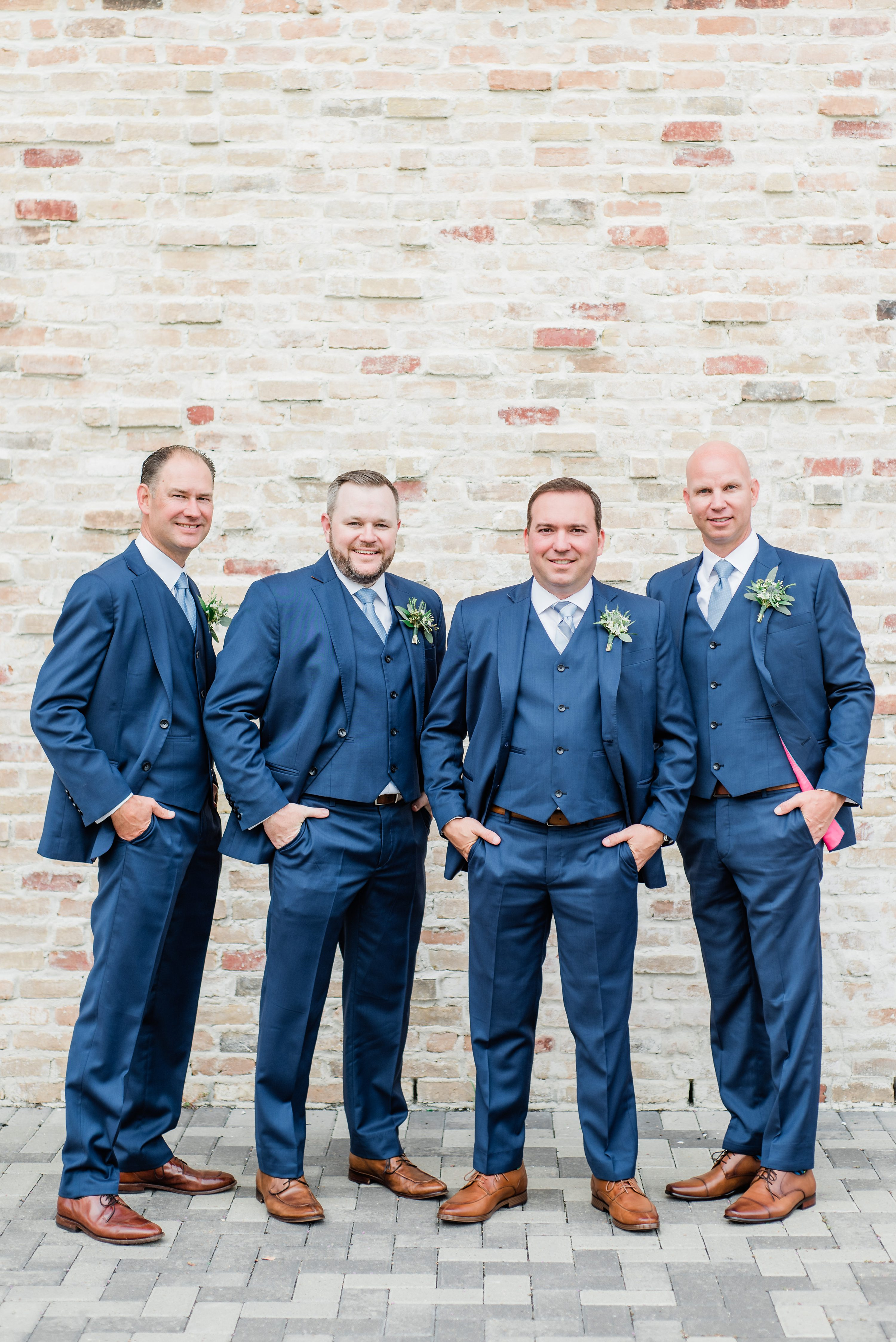 and we loved the way the decorated the barn with tons of greenery and a neutral color palette. They ended the wedding with a fun sparkler exit surrounded by their family and friends, while the groomsmen wore custom tailored blue suits. Their romantic ceremony was so full of emotion