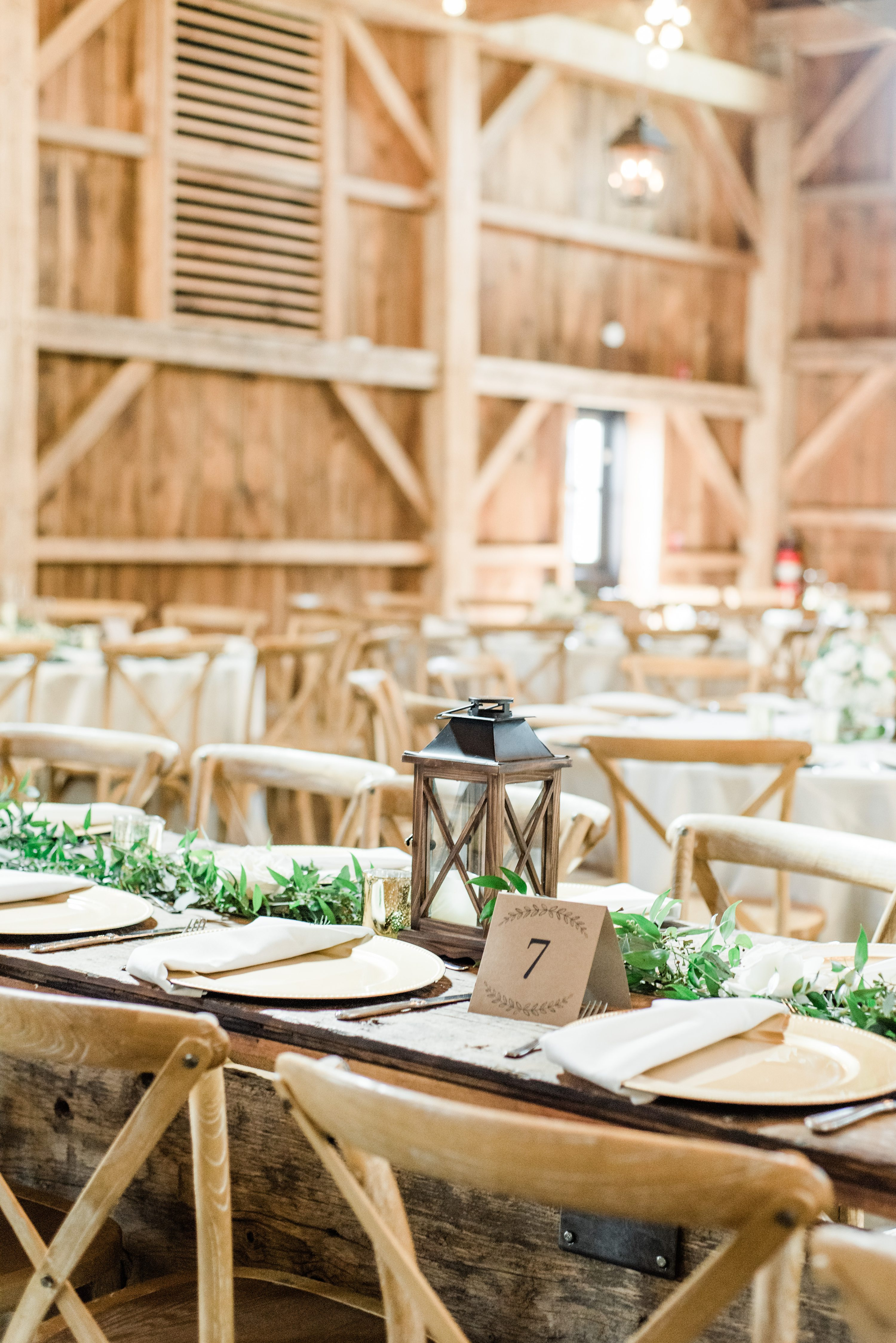 Husband & Wife Team, and we loved the way the decorated the barn with tons of greenery and a neutral color palette. They ended the wedding with a fun sparkler exit surrounded by their family and friends