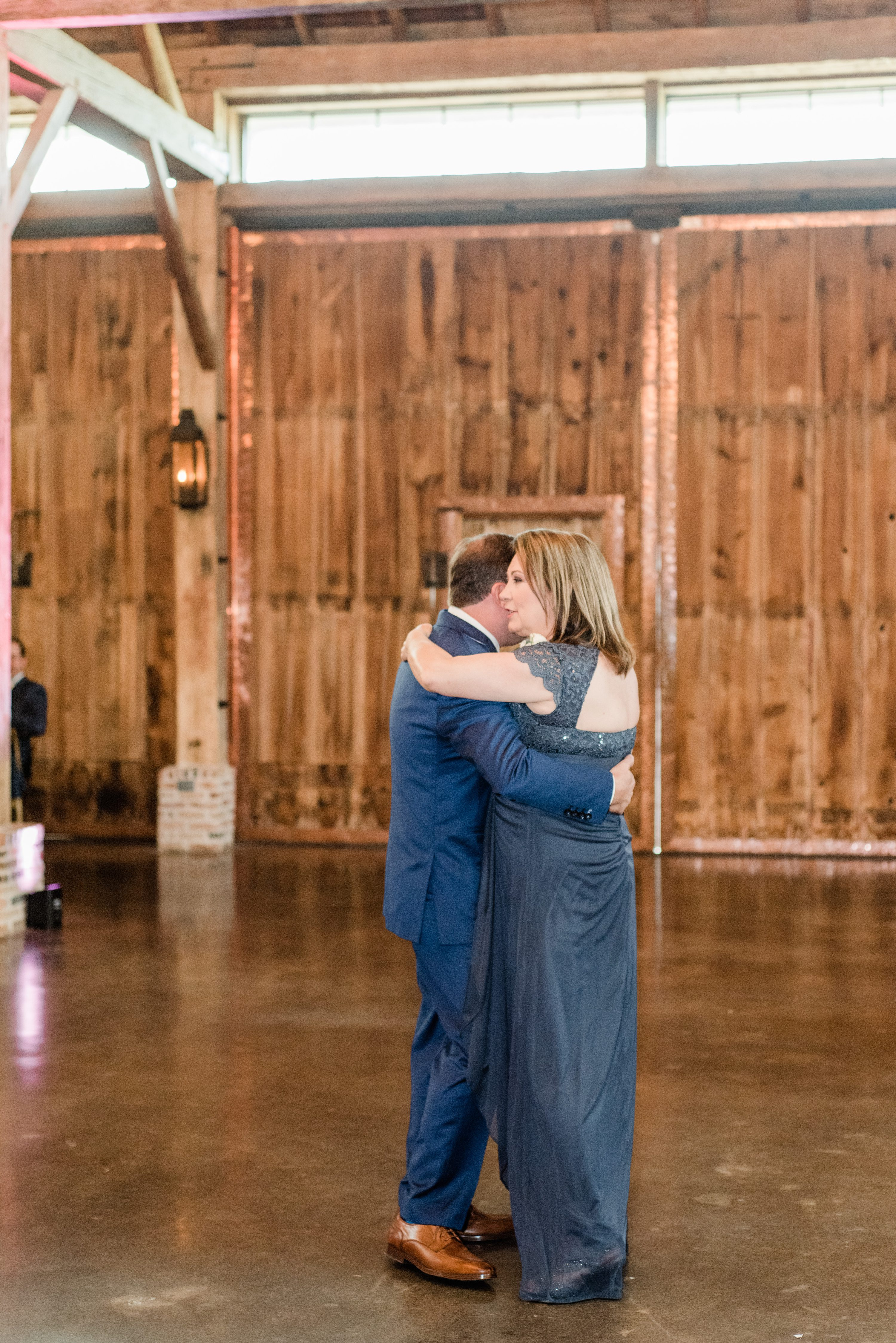and we loved the way the decorated the barn with tons of greenery and a neutral color palette. They ended the wedding with a fun sparkler exit surrounded by their family and friends, especially when Travis cried seeing his bride for the first time. Their reception decor was absolutely stunning