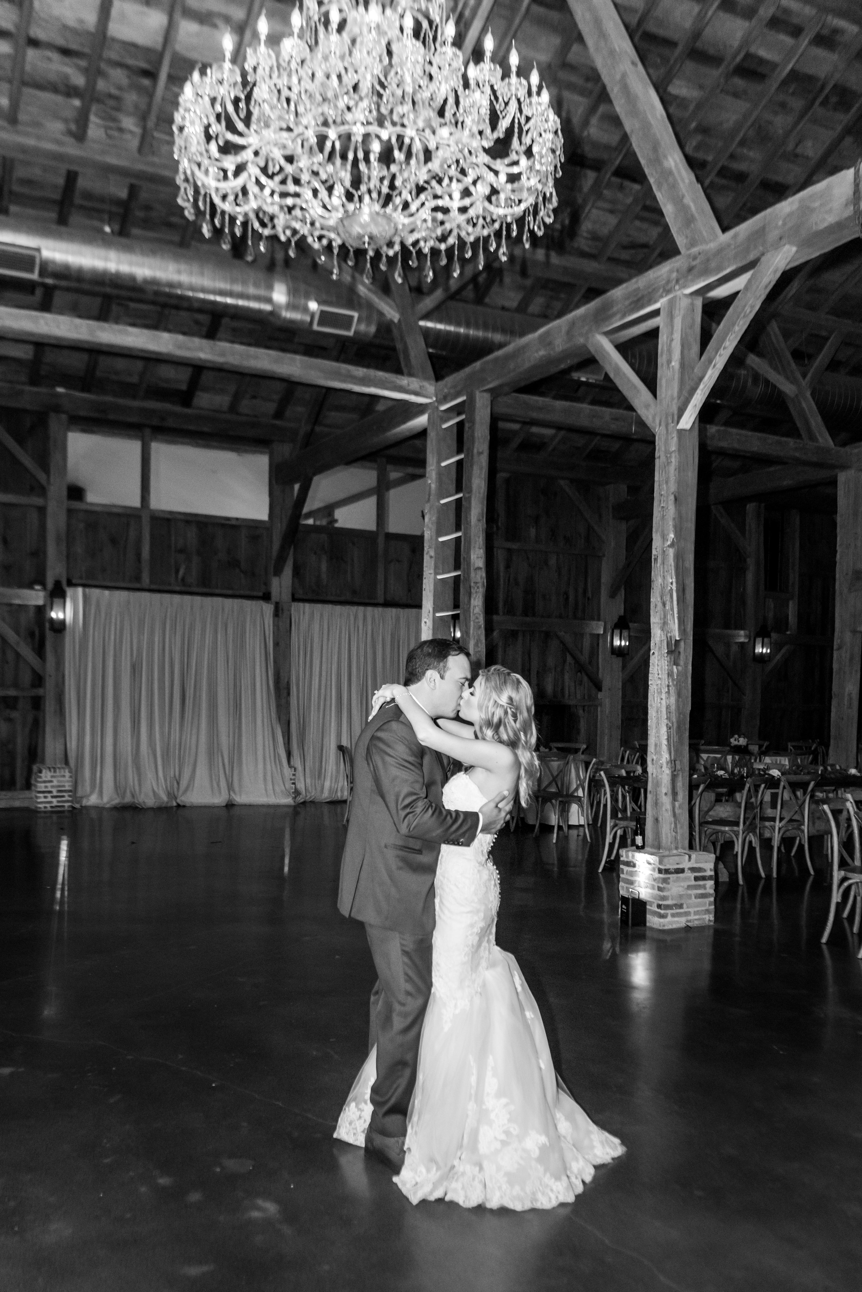 Laura and Travis got married at the gorgeous Beckendorff Farms, and we loved the way the decorated the barn with tons of greenery and a neutral color palette. They ended the wedding with a fun sparkler exit surrounded by their family and friends