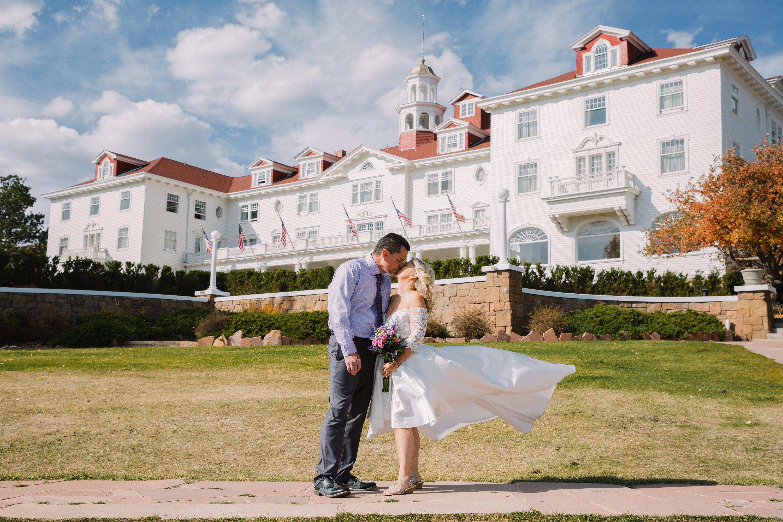 estes park,colorado,the stanley hotel,bride and groom,high low wedding dress