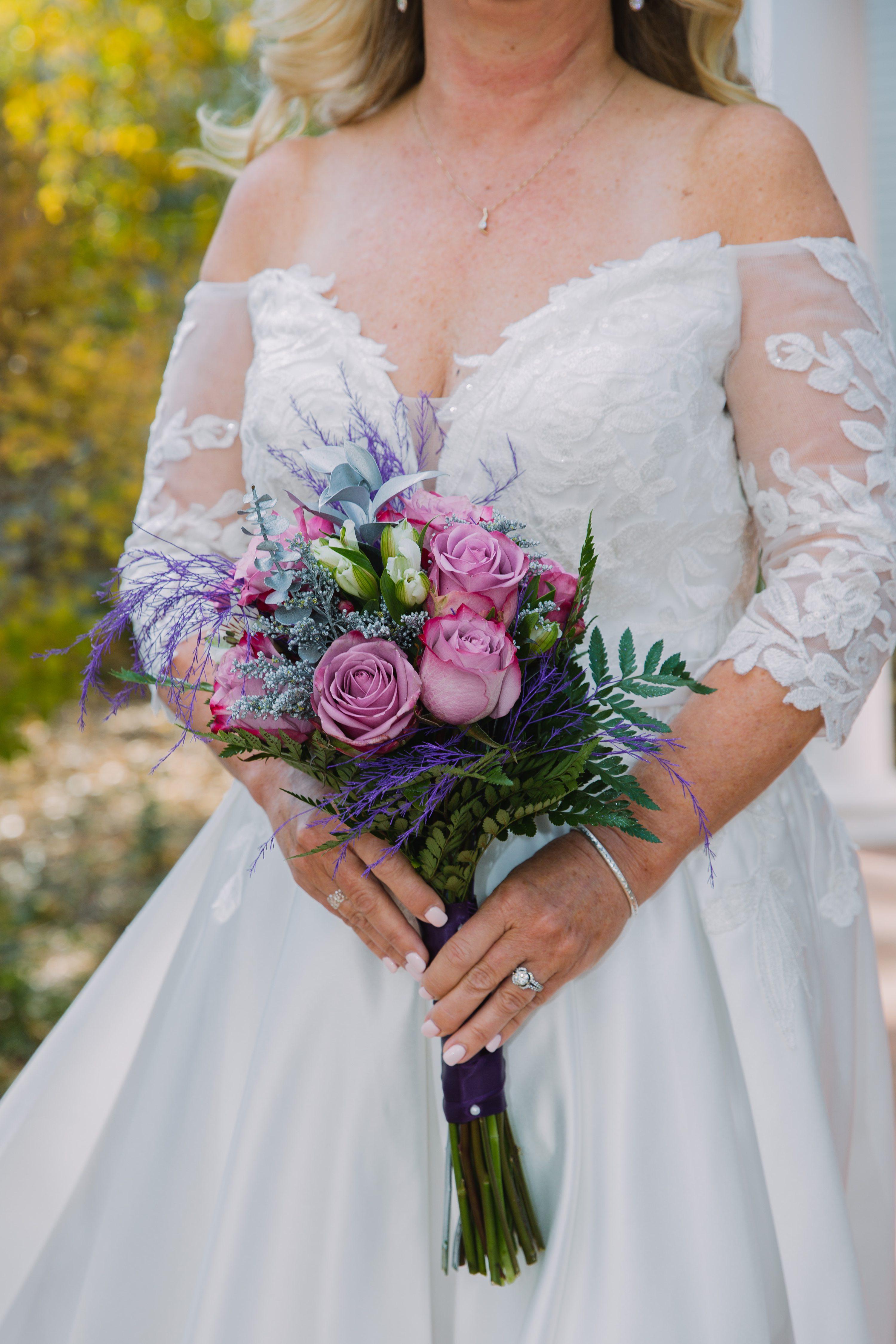 bouquet,bride,off shoulder wedding dress